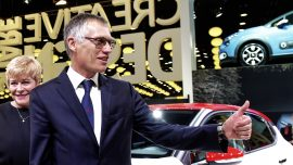 PSA buys Opel from GM, sets recovery goals