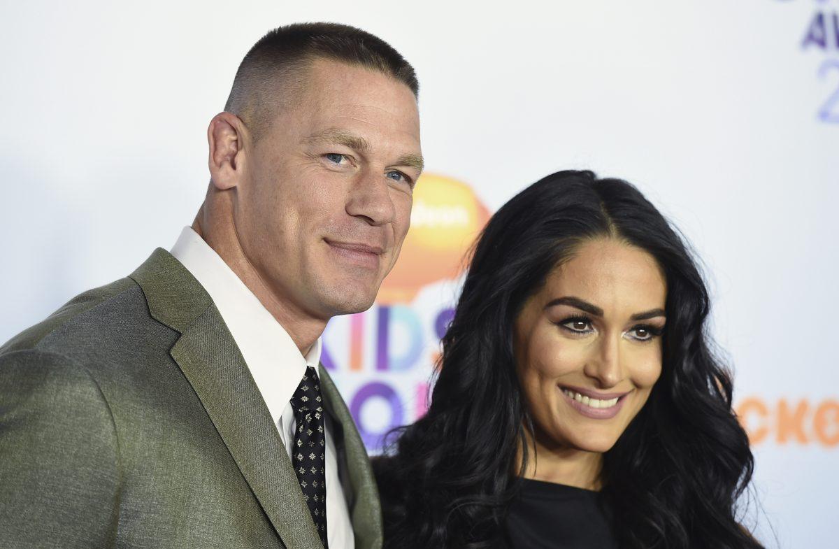 John Cena, left, and Nikki Bella arrive at the Kids' Choice Awards