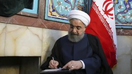 Iran election: people pick between moderate or hardline candidates