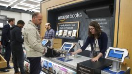 Amazon stocks shares top $1,000 milestone