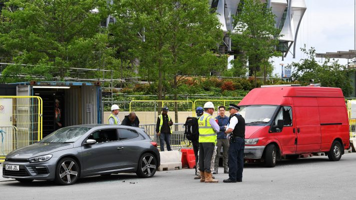 Police stand beside two vehicles in which they carried out controlled explosions near the new but still unoccupied US embassy building in south London, on June 7, 2017. (Justin Tallis/AFP/Getty Images)