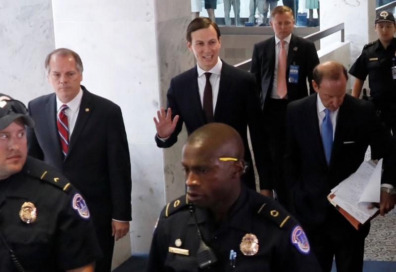White House Senior Adviser Jared Kushner waves as he and his attorney Abe Lowell (R) depart following Kushner's appearance before a closed session of the Senate Intelligence Committee as part of their probe into Russian meddling in the 2016 U.S. presidential election, on Capitol Hill in Washington, U.S. July 24, 2017. (REUTERS/Jonathan Ernst)