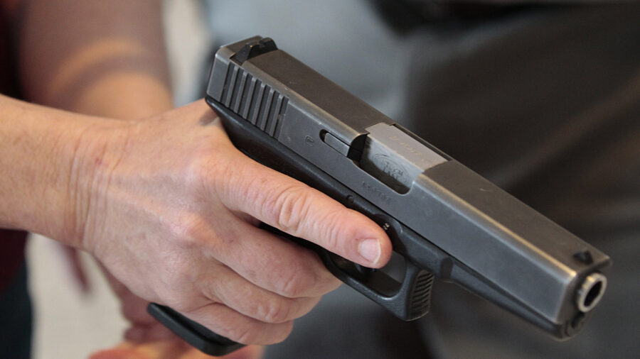 Kansas Lawmakers Override Governor's Gun Bill Veto, Lowering Concealed Carry Age to 18