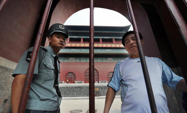 Low-Level Chinese Regime 'Flies' Take High-Level Graft