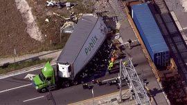Train Hits Truck Full of Groceries, Food Flies