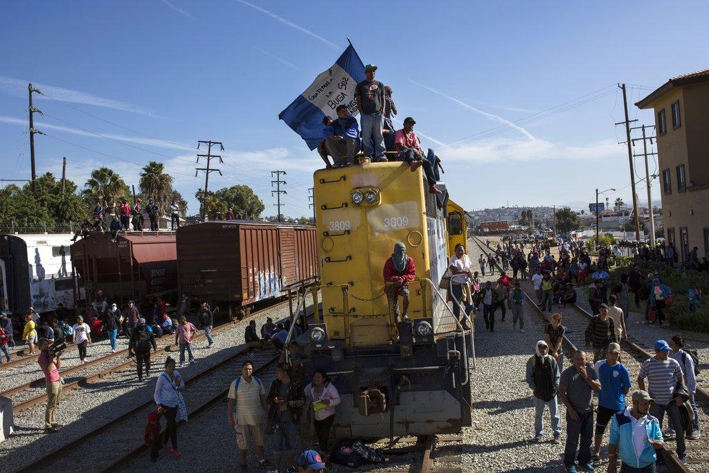 Migrants wave Honduran flag