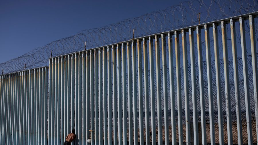 Video Shows Migrant Toddler Falling in Climb Over Border Wall