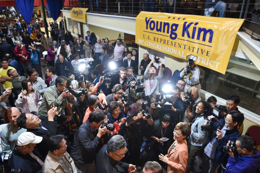Republican Congressional candidate in California's 39th District Young Kim (R) is surrounded by supporters and media as she arrives