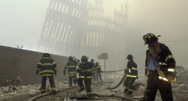 The skeleton of the World Trade Center twin towers in the background