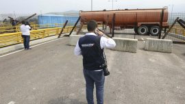 Venezuela Military Barricades Key Bridge to Stop Aid and Food