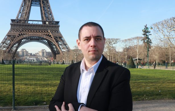 Police Syndicate Leader Michel Thooris poses in front of Eiffel Tower.