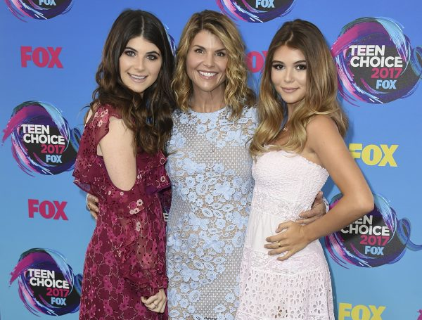 Actress Lori Loughlin, center, poses with her daughters Bella, left, and Olivia Jade