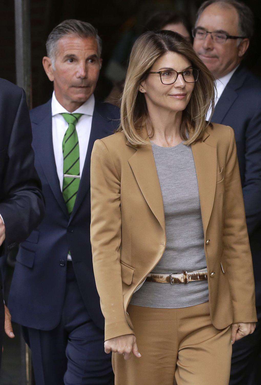 lori loughlin with husband walking