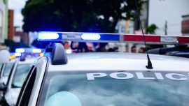 Murder Suspect Arrested After Vehicle Chase Ends in Crash