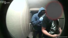 Surveillance Video Shows Armed Men Forcing Father Into House at Gunpoint