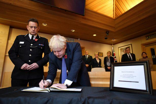 Boris Johnson signs a book of condolence