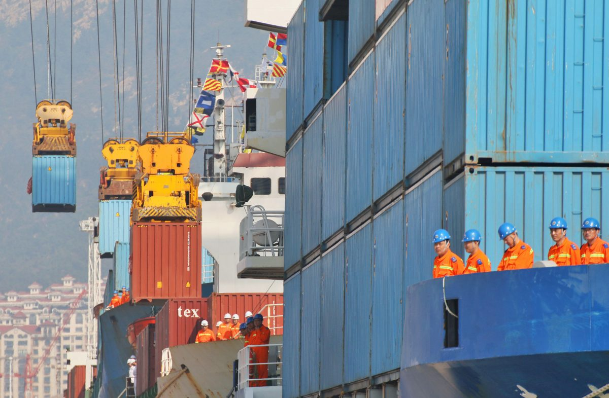 cranes lifting containers