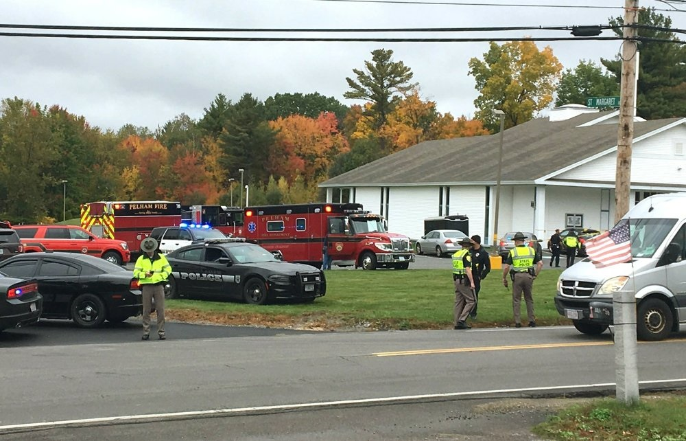 Police stand outside the New England Pentecostal Church after reports of a shooting ,