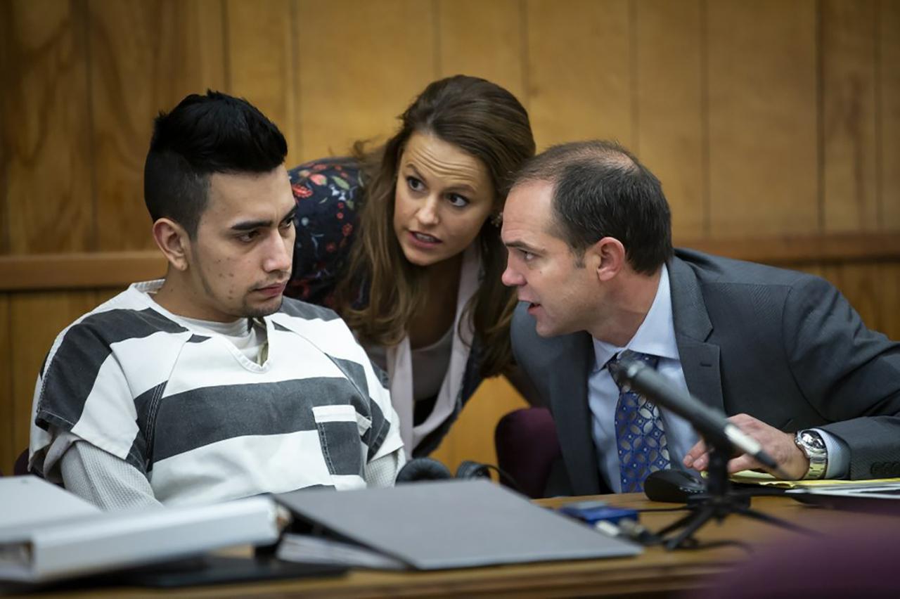 Cristhian Bahena Rivera talks to his defense attorney.