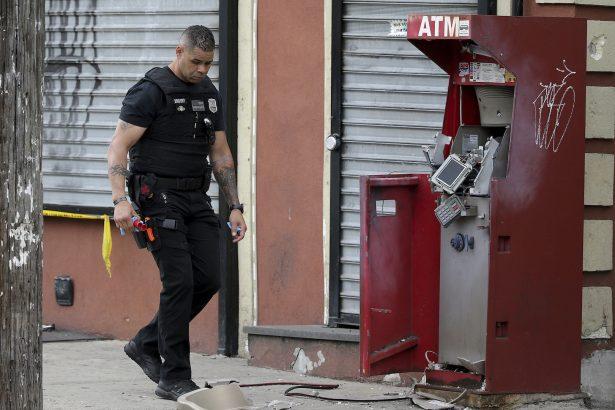 A member of the Philadelphia bomb squad surveys the scene
