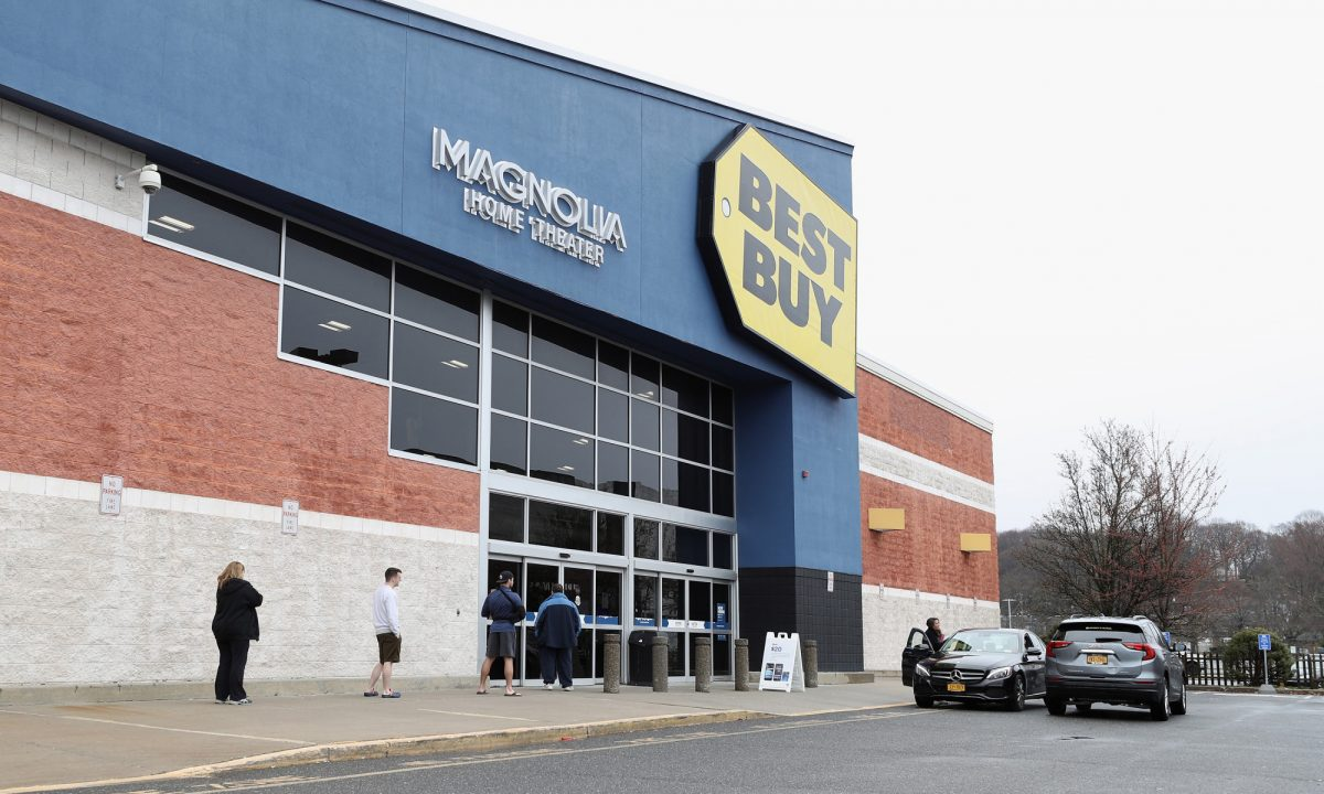 People wait in line at a Best Buy