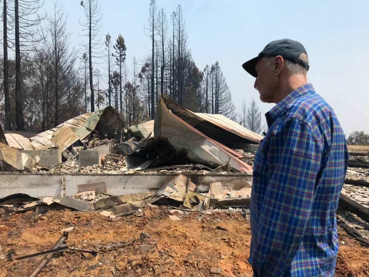 Charles Christianson returns to his destroyed home
