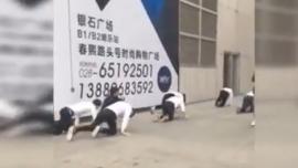 Employees Crawl in Public as Punishment