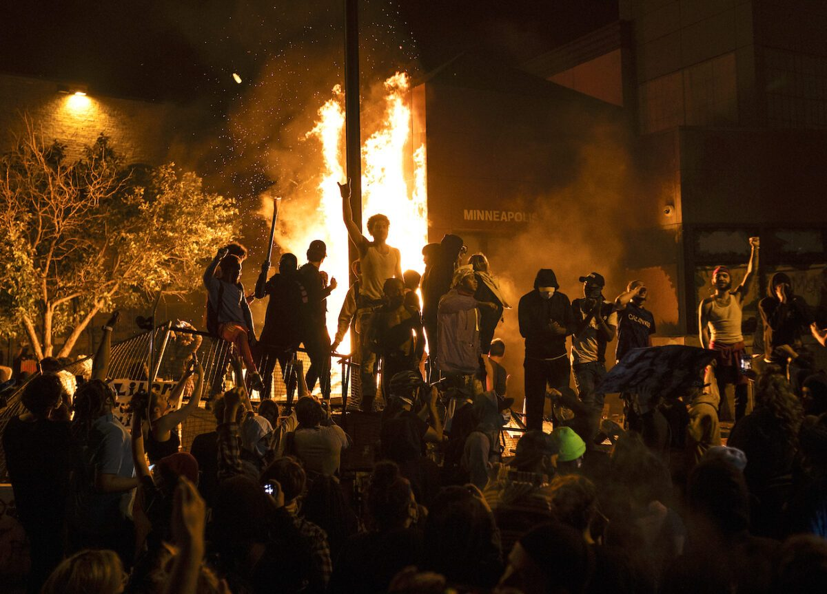 Rioters cheer as the Third Police Precinct