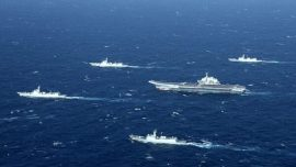 Chinese Navy Chases Civilian Ship in South China Sea