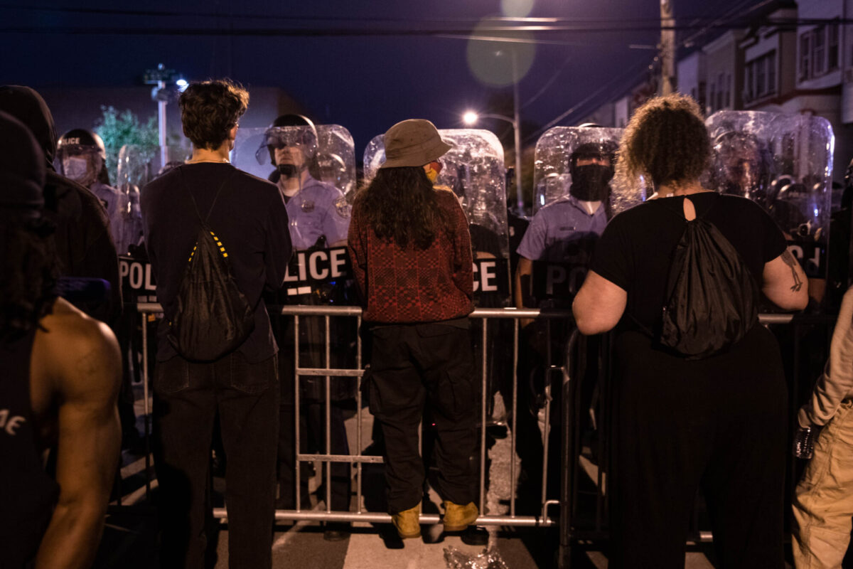 Protesters face police in riot gear