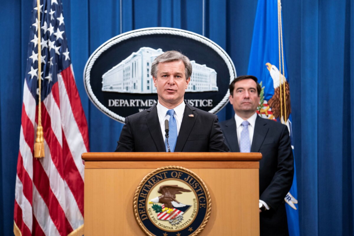 FBI Director Christopher Wray attends a virtual news conference at the Department of Justice in Washington