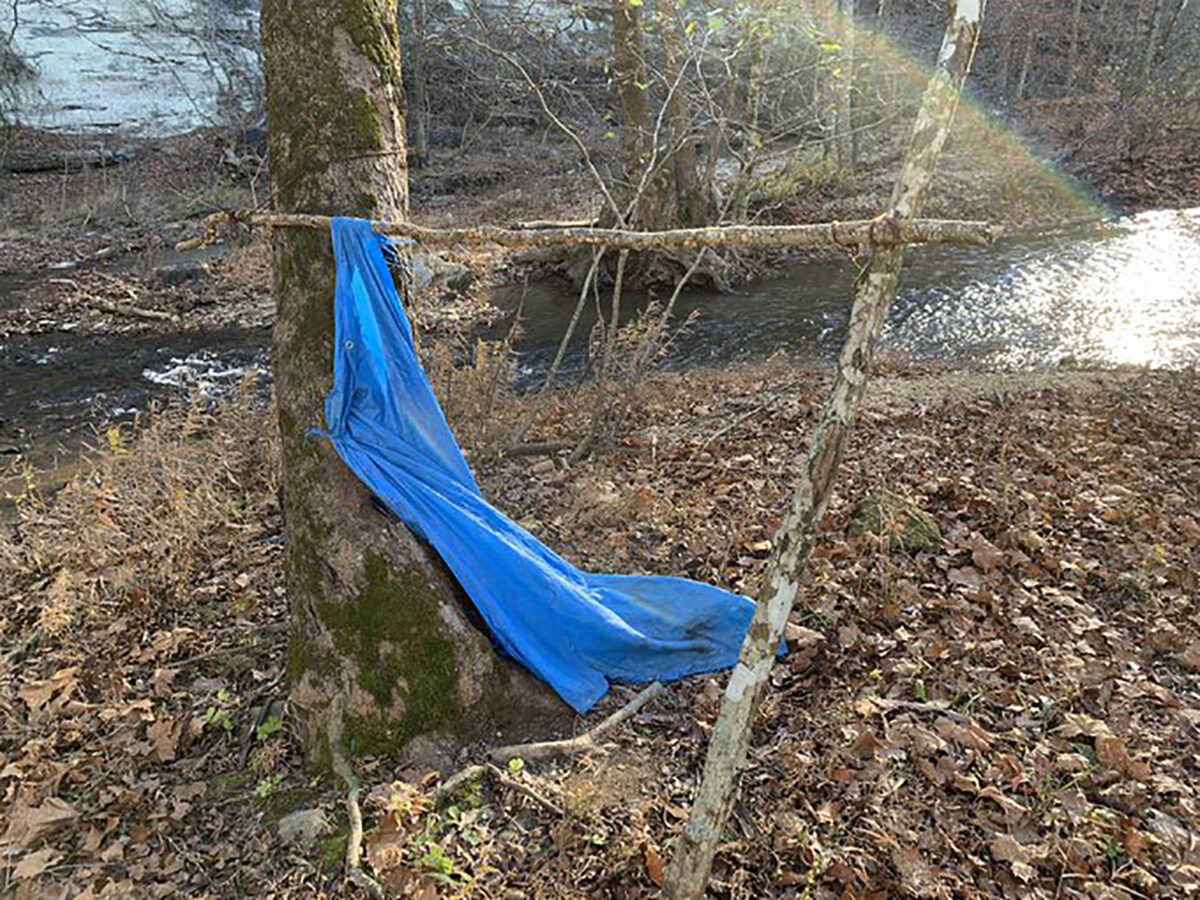 The creekbed and tarp where Jordan Gorman was found
