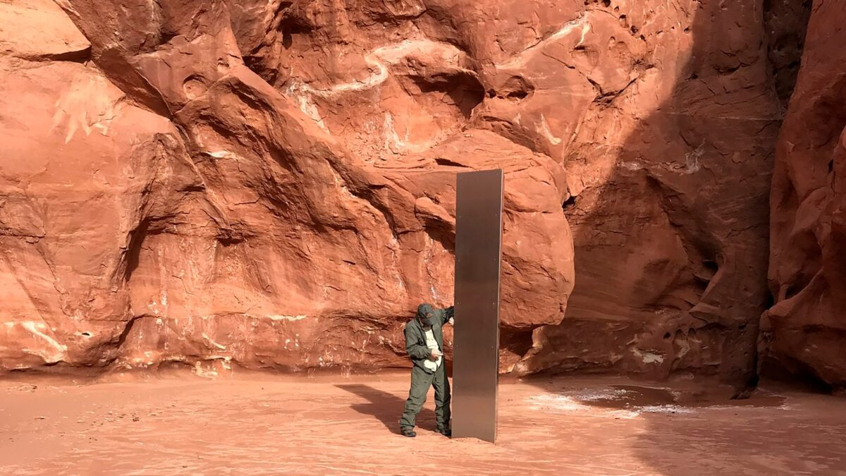 inspects a metal monolith