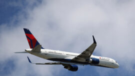 2 Delta Passengers Open Door of Moving Plane and Slide out With Dog at NY Airport