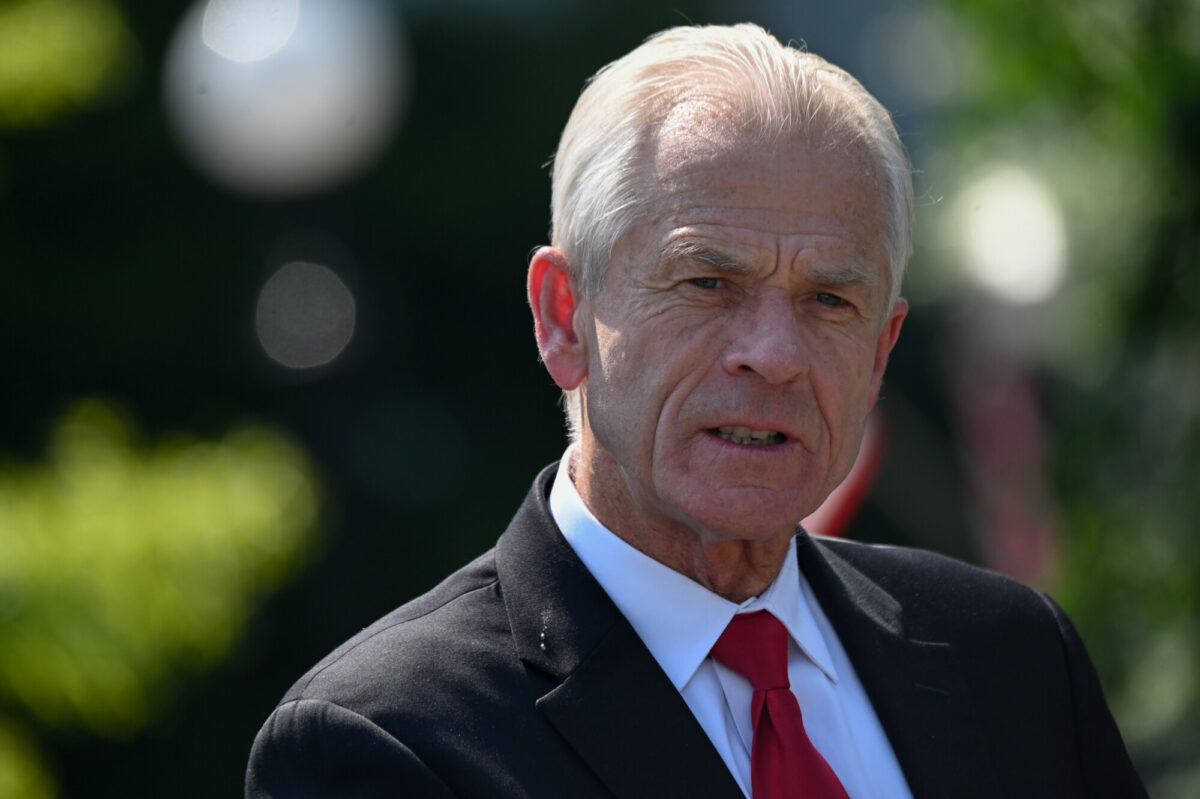 White House adviser Peter Navarro speaks to reporters outside the West Wing in Washington