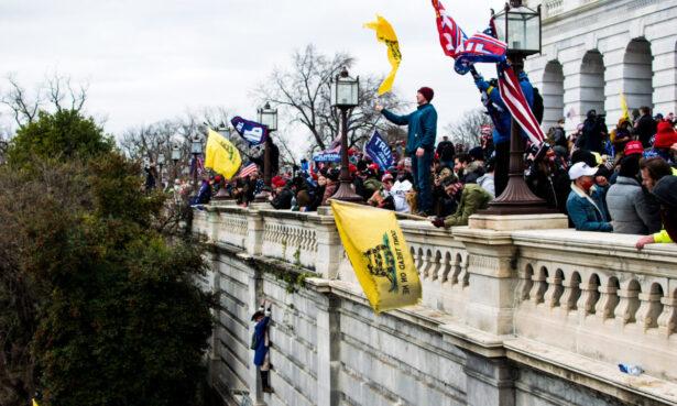Protesters stand on the veranda