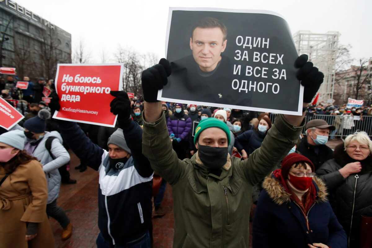 Navalny supporter holding a placard