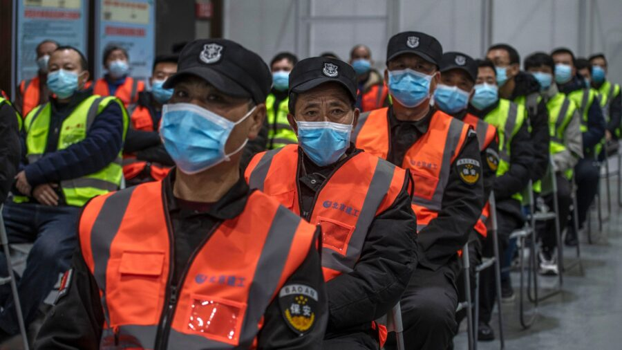 Two More Chinese Cities Go Under Lockdown, as Beijing Mandates Four-Week Quarantine for Travelers