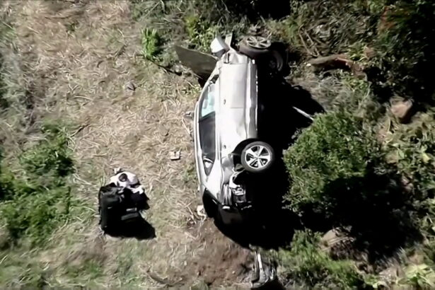 The vehicle of golfer Tiger Woods lies on its side after being involved in a single-vehicle accident in Los Angeles