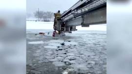 Rescuers Brave Cracking Ice to Pull Two From Sinking Truck