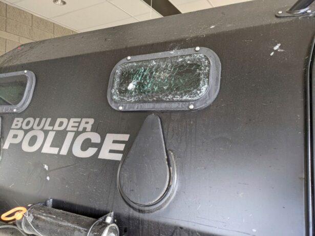 Cracked windows of a patrol vehicle