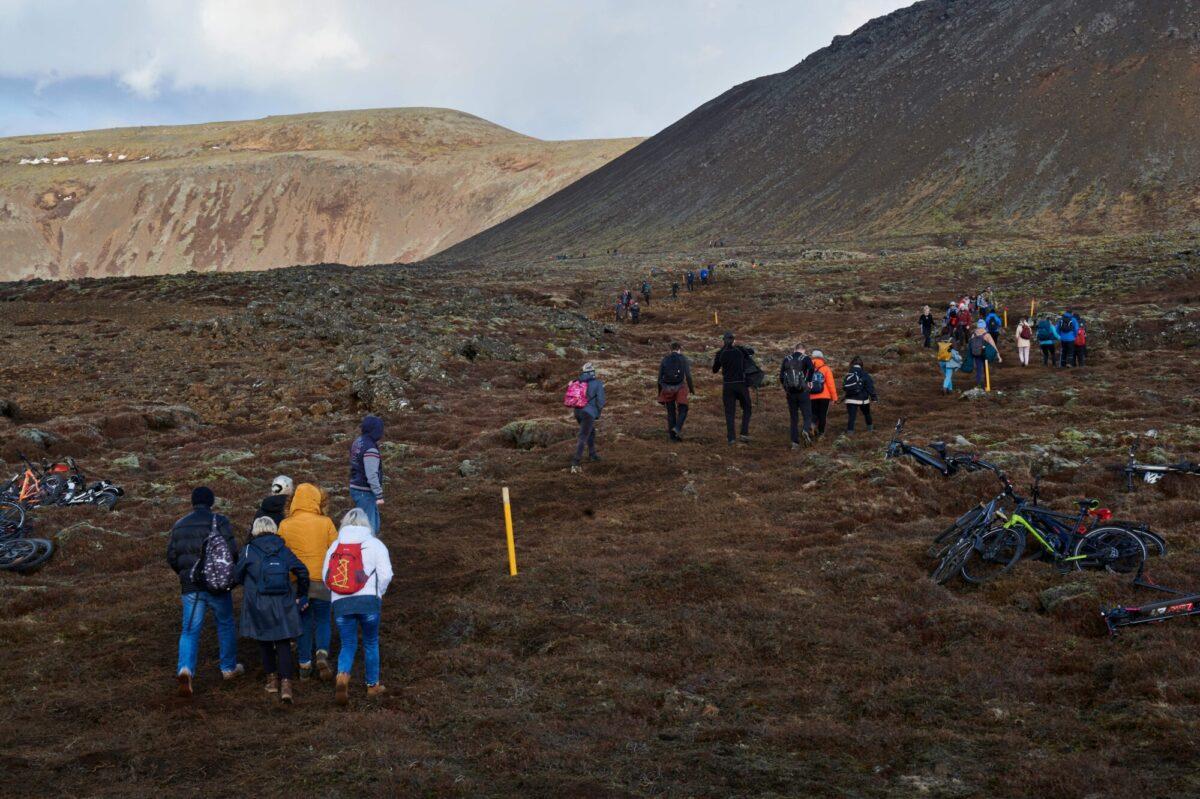 Hikers walk towards Fagradalsfjall area