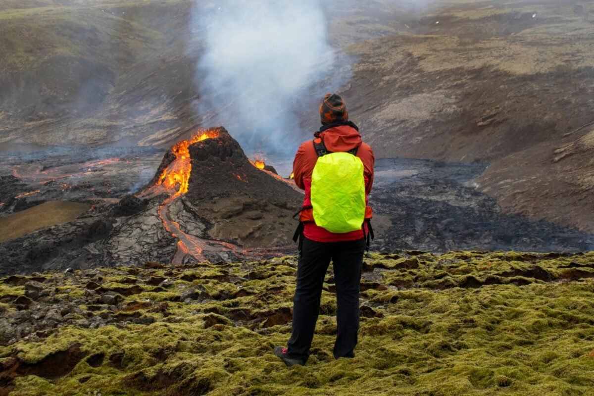 Hikers look at the lava flowing