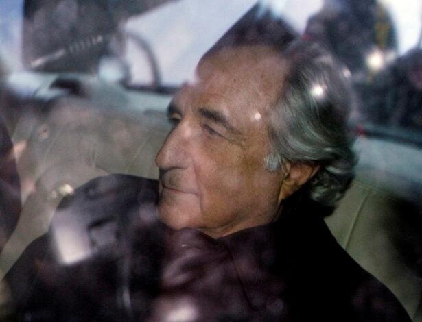 Bernard Madoff is escorted