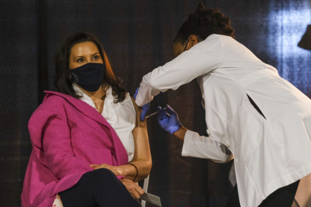 Gretchen Whitmer receives a dose of the Pfizer