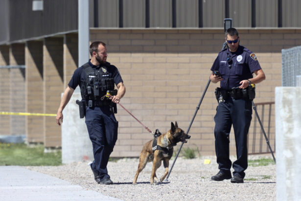 Police walk outside Rigby Middle School following a shooting