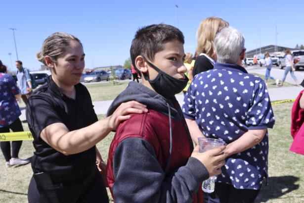 Adela Rodriguez, left, walks with her son, Yandel Rodriguez