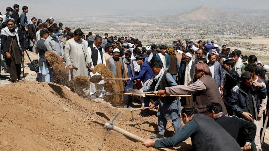Afghan School Blast Toll Rises to 68, Families Bury Victims