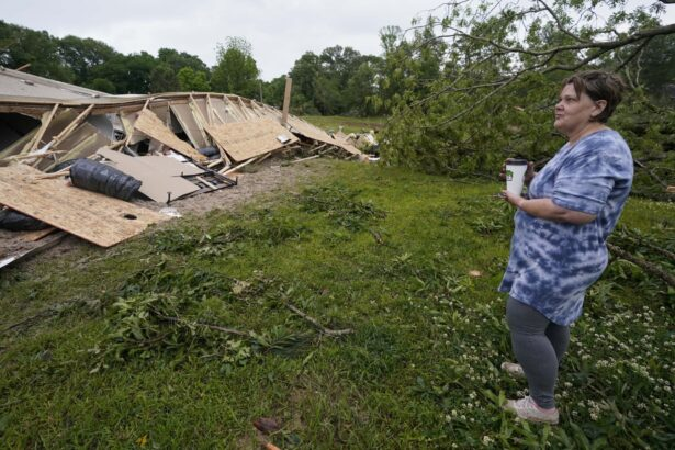 Vickie Savell looks at the remains of her new mobile home early