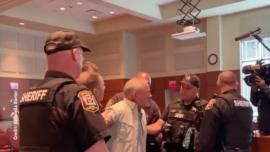 School Board Meeting Ends in Singing, Arrests